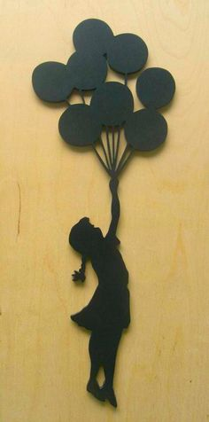 Banksy Girl With Balloons Wood Silhouette Wall Art Cut Out. $12.00, via Etsy.