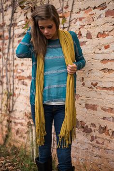 We believe in a thing called love, just listen to the rhythm of our hearts whenever we set our eyes on this sweater! The thin material makes for a light, easy fit and we are obsessed with that teal color! We can't resist such cozy grey stripes, either!
