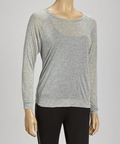 Revel in fashion filled with casual day-to-night comfort. Relaxation ensues when the perfect blend of soft, lightweight materials come together in this solid top.