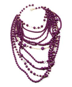 For a statement bauble with stately appeal, look no further than this aubergine necklace. Layers of beads and faceted crystals drape necks with regal excess.