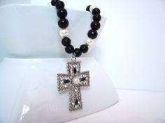 Hey, check out this really awesome Etsy listing that I made at https://www.etsy.com/listing/168440380/metal-christian-cross-pendant-necklace-w