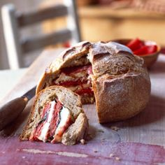 This stuffed picnic loaf is simply delicious. Raid the local deli, pick up a fresh-from oven loaf and some local cured meat and cheese.