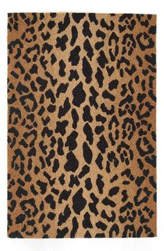 - A cozy rug is woven from pure, micro-hooked wool and colored in a chic leopard print for an edgy, eye-catching update to any room. - 100% wool. - Professional clean. - By Dash & Albert; imported.
