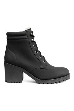 Boots in faux nubuck. Ankle-high leg section with padded edge and lacing at front. Pile lining, pile insoles, and chunky rubber soles. Heel height 3 in.