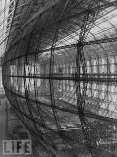 "October, 1934: The vast and intricate framework of zeppelin model LZ 129, under construction at Friedrichshafen, Germany. With a gas capacity of 7,070,000 cubic feet, and christened ""Hindenburg,"" she became the largest — and ultimately, for all the wrong reasons, the most famous — airship the world has ever seen."