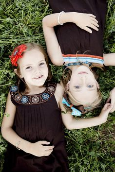 sisters... gonna have to try to get my girls to lay still for a picture like this