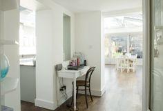 white walls, modern baseboards, nice hardwood
