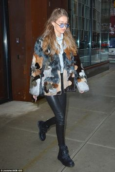 Eclectic: The model donned a patchwork fur jacket and leather pants...
