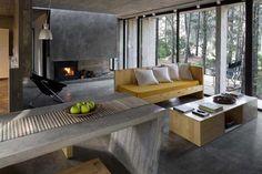 Floresta abraça casa feita de concreto – Casa Vogue