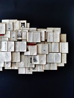 old books as wall display | Interior Details and Signage for Edmund's Oast
