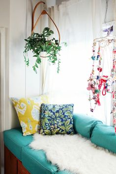 I want this thing that hangs off the wall so my plants don't get all crunched up in the back.