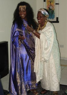 H.I.M Empress Shebah 'Ra - Queen Shebah III and throne lines Ga-Dangme(Nubian-Kushite) Queen enjoy a laugh at one of the Imperial Matriarchs private residence. Royal Galleries