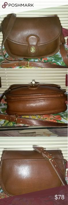 """COACH """"RARE"""" VINTAGE PRAIRIE BAG, made in USA! Vintage Coach Prairie bag. Very good Vintage condition. No scuffs, marks on exterior making this vintage bag very special! There are a few ink marks inside. The Leather is butter soft and a beautiful color! Small in size but holds alot with 2 separated compartments inside and one zipper pocket on back wall. 9.5in wide x 8in ht. 24 in adjustable strap drop. Crossbody or shoulder. Coach Bags Crossbody Bags"""