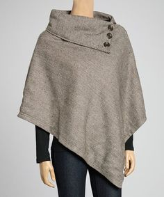 Undeniable timeless and unquestionable fashionable, the poncho never fails! This ode to the classics features a lovely herringbone print and a signature cowl for a classic look.