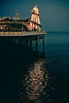 Brighton Pier, England. In its original form in 1823 Brighton Pier was an Old Chain Pier which was primarily used as a landing stage for  passenger ships that sailed from Dieppe in France. Today it is a popular pleasure pier.