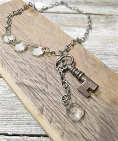 This vintage key necklace with antique chandelier crystal