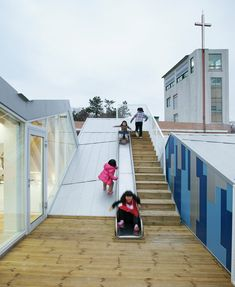 Inspired and with a great view:  A playground slide is tucked into the rooftop folds of this children's centre in a coastal South Korean village by Seoul studio JYA-RCHITECTS    http://www.dezeen.com/2013/03/24/gangjin-childrens-centre-by-jya/