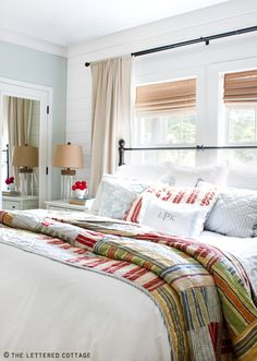 Vintage reds, greens, yellows and blue with pale blue and white. Natural & black accents. Looks casual but put together in a comfortable way #TheLetteredCottage #Bedroom #ColorCombo
