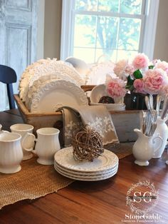 6 TIPS FOR CREATING A KITCHEN TABLE VIGNETTE...love the way the plates are displayed upright in the distressed wood caddy.