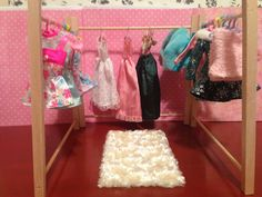 DIY Barbie closet insert.  What a cute way to keep the clothes put away :-)