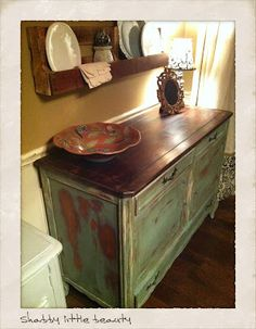 Sideboard, green distressed finish with dark stained top; this could make a great sink base in a bathroom.