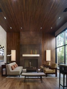 Living room with wood paneling on the wall and ceiling.