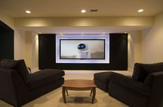 Interior Designs,Enticing Home Workout Room Ideas With Comfortable Black Fabric Sofas On Combined Brown Wooden Table On Rug And Cool Tv Wall Unit,Modern Home Workout Room Ideas