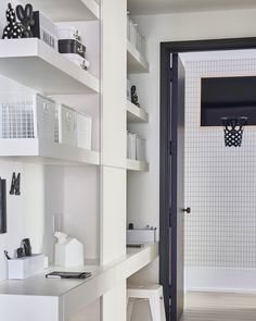 Homework station + kids space + playroom + basketball hoop + grid wallpaper + white built-in shelves + two-person desk + homework desk + basket storage + white metal stool + white and navy Oversized Round Mirror, Youth Rooms, Kids Rooms, Kids Clothes Storage, Grid Wallpaper, Wall Bench, Canopy Frame, Arched Windows, Playroom Decor