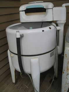 My mom used this type of washer when I was a kid. I remember wringing out clothes through that wringer on top!