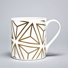 Alfred & Wilde's lovely bone china mugs! A set of five fantastic white fine bone china mugs, hand-decorated in Stoke-on-Trent with 9 carat gold.  The gold geometric patterns are based on the Platonic Solids, a series of five solid shapes named after the Ancient Greek thinker Plato. The solid shapes are symmetrical, and each is made up of faces that are the same shape.  #elds #eastlondondesignstore #alfred&wilde #coolmugs