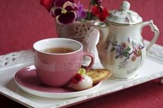 So cute!  http://www.123rf.com/photo_6610741_tea-cup-and-tea-pot-on-a-tray-with-cookies-and-a-little-vase-with-flowers.html