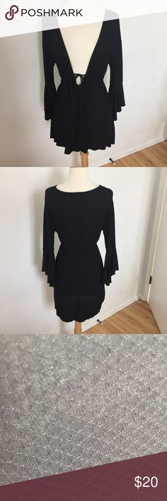 C67 Fredricks of Hollywood Black Swim Coverup Cute low cut waffle textured swim coverup dress. Can also be worn as a regular dress. Tie waist that tightens. No flaws! Tag size small. Frederick's of Hollywood Swim Coverups