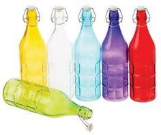 Garrafa de vidro colorida - Estilizada. Capacidade: 1 Litro. Ideal para expor bebidas em bares ou como peça de decoração. Tendência absoluta em festas, as garrafas coloridas prometem deixar o ambiente mais divertido. #decoracaodefestas #enfeitesdivertidos #chabar