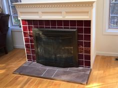 "Handmade ceramic tile surround with 12""x24"" porcelain tile hearth."