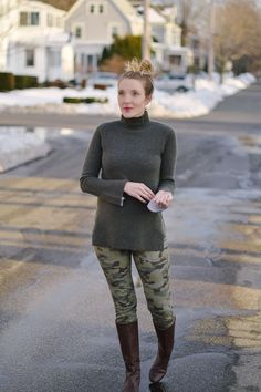 styling skinny camo pants with a cashmere turtleneck sweater and knee high boots // Leslie Musser one brass fox