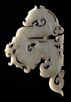 Jade Dragon Pendant, 2nd century BC, Western Han Dynasty, Length: 18 cm; Width: 11.9 cm, Unearthed at Shizishan site 1994-1995, Xuzhou Museum, Jiangsu Province.