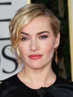 Kate Winslet updo with long, side-swept bangs, flushed cheeks and rosy lipstick