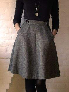 Turtleneck and tights. A classic look with this pocketed wool skirt.