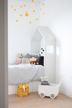 white house bed . yellow stars . Kids room