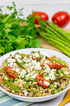 summer salad? Try roasting the tomatoes and asparagus! This Farro ...