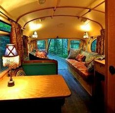 This tiny bus converted Into a motorhome reminds me so much of the old gypsy caravans.  I love it!
