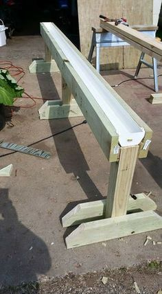 Gutter garden on raised stand - great idea for patio or balcony. Accessible for wheelchair. #AquaponicsTips