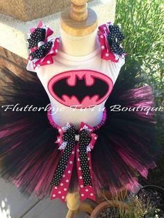 Apparently my girls are now going to be superheroes this halloween...finally not princesses!  Miss Bat Batman TuTu Set by flutterbyetutu on Etsy, $51.50