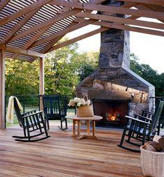 outdoor fireplace; beams, metal roof