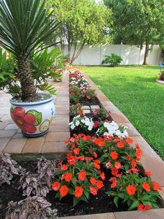 An exquisite flower border is the icing on the cake for this pretty patio.