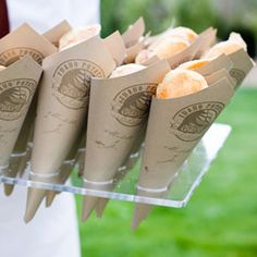 DIY cones for takeaways: flowers, taffy, dipped pretzels, etc. * maybe we could glue doulies (or however you spell that) together to make these cone shaped holders! :D
