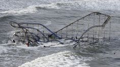 Sandy    Waves wash over a roller coaster from a Seaside Heights, N.J. amusement park that fell in the Atlantic Ocean during superstorm Sandy on Wednesday, Oct. 31, 2012. (AP Photo/Mike Groll)