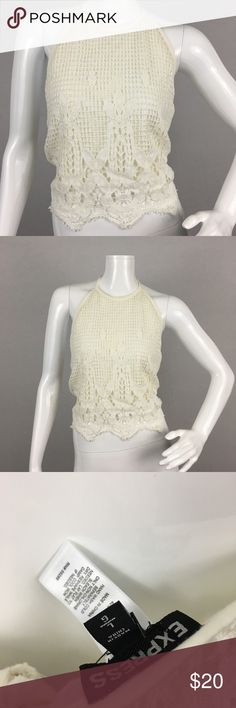 """Express Ivory Crotchet Halter Crop Top Boho Large Express Ivory Crotchet tie back Halter Crop Top. New with tags. Size large. Armpit to Armpit 17"""" (tied tightly in the back, you can loosen as needed) Length 9"""" from under arm to bottom of shirt. 100% Cotton, lining is 60% cotton 40% modal. Original price $34.90. This Top is perfect for the upcoming warm weather. Pair it with some high waisted jeans or a distressed mini skirt for a perfect look!  Thanks for looking! Express Tops Crop Tops"""