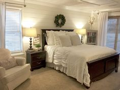 Shiplap bedroom walls with farmhouse charm... magnolia wreath and Alabaster White paint!