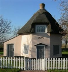 One of two octagonal Dutch cottages (built for Dutch workers) from the 17th century which are preserved on Canvey Island. This cottage now functions as a museum. Canvey Island is a civil parish and reclaimed island in the Thames estuary in England. It is separated from the mainland of south Essex by a network of creeks. Lying only just above sea level it is prone to flooding at exceptional tides, but has nevertheless been inhabited since the Roman invasion of Britain.